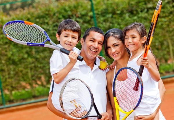 family playing tennis lesson