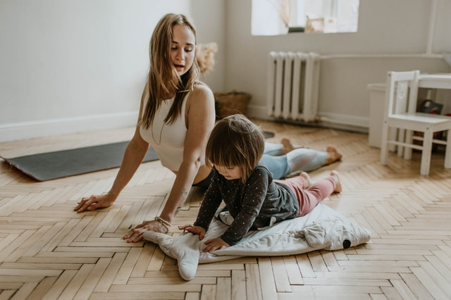 woman exercising with kid to achieve work life balance
